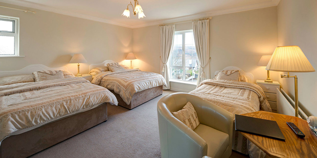Family ensuite bedroom – room contains one double and two single beds with ensuite facilities, suitable for 4 occupants.