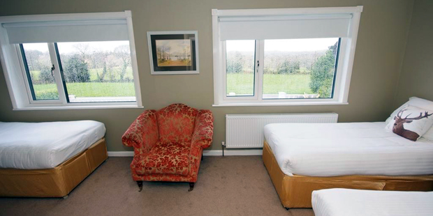 Triple ensuite bedroom – room contains three single beds with ensuite facilities, suitable for three occupants.